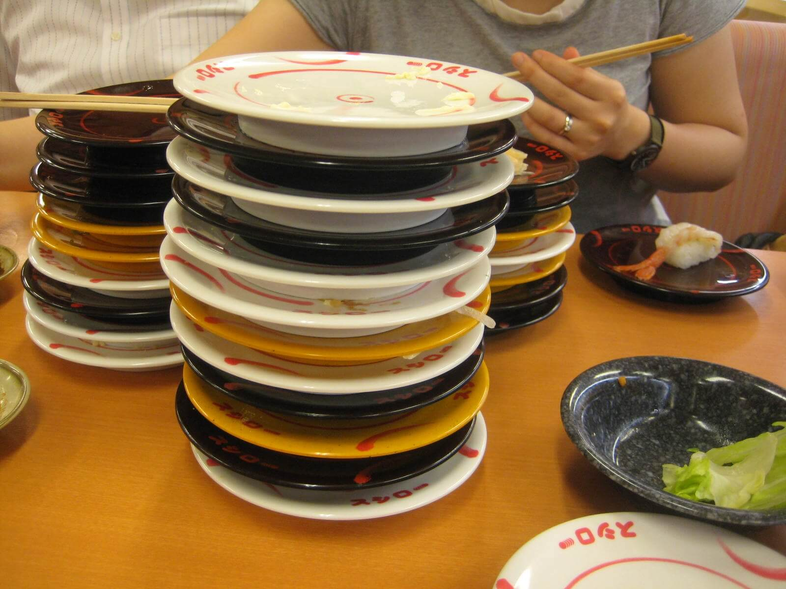 Stacked sushi plates Arigato Japan Food Tours