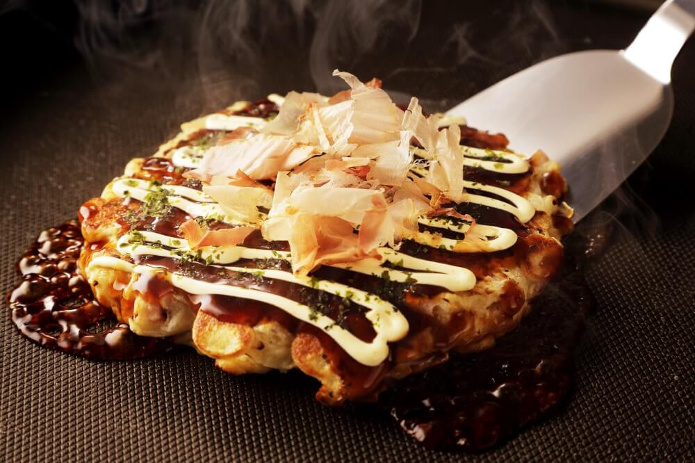 fish flakes on okomomiyaki